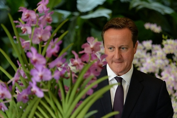 British PM David Cameron with the orchid grown in his honour
