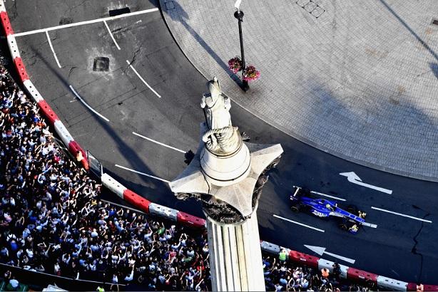 An F1 car passes under Nelson's column in central London (Credit: Dan Mullan)