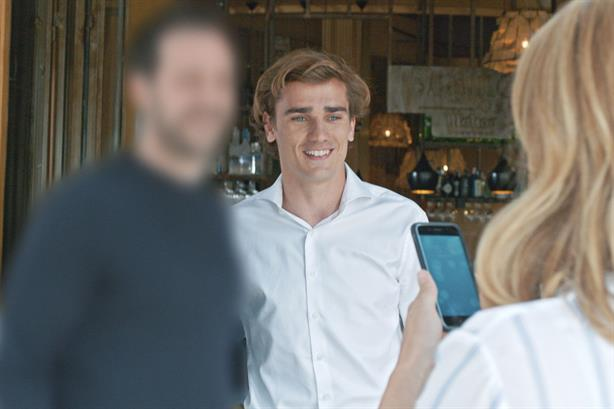 Footballer focus: Antoine Griezmann (c) called in for Huawei blurry man campaign