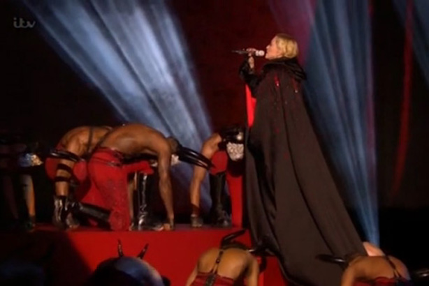 Madonna: Fell over her Armani cape during her performance at the BRITs last night