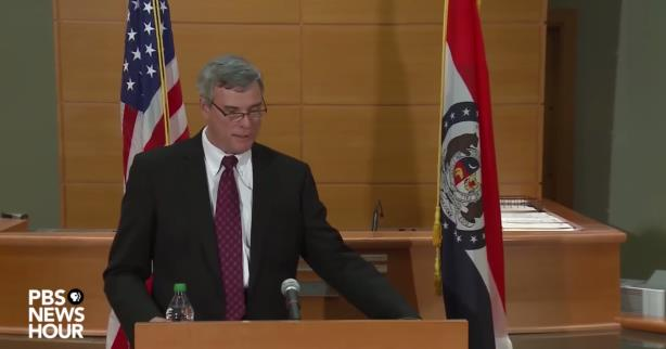 A screenshot of PBS NewsHour's coverage of the McCulloch press conference