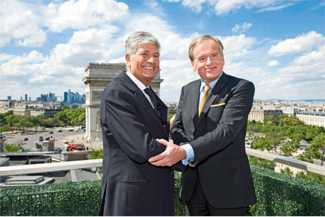 It's a deal: Maurice Levy (left) and John Wren shake on the merger (Credit: Getty Images)