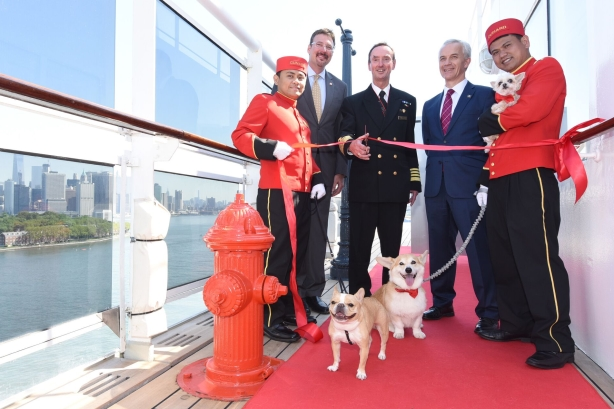 Instagram dogs and Cunard execs at the ribbon-cutting ceremony.