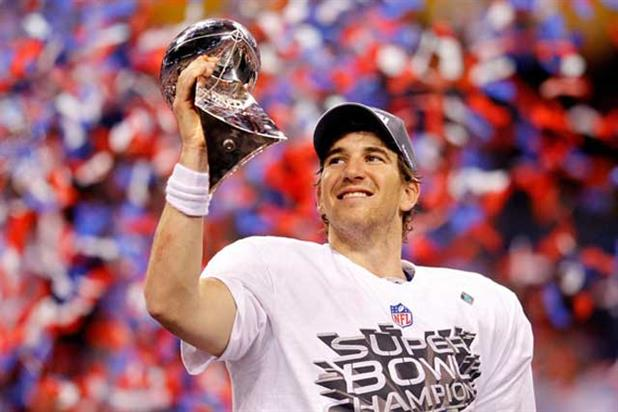 Eli Manning lifting the Super Bowl trophy
