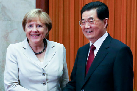 Closer ties: German chancellor Merkel with China premier Jiabao (Credit: Getty Images)