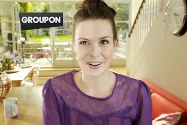 Groupon: daily deals service cuts back on marketing spend