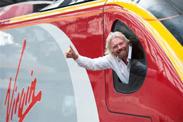 Sir Richard Branson: his Virgin Trains group retains West Coast line for two years