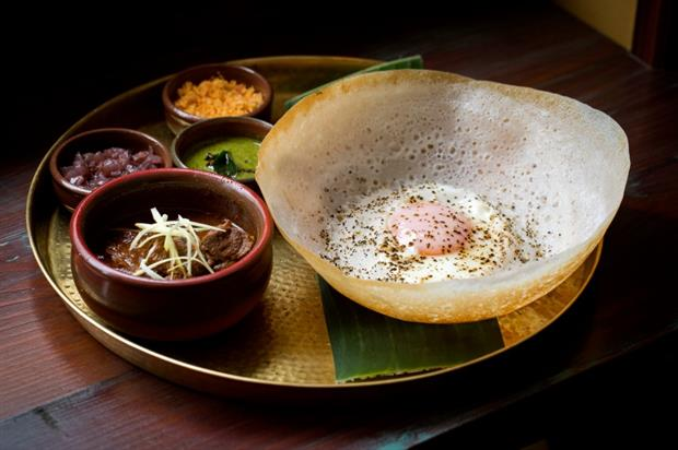 An egg hopper and lamb kari dish by Soho restaurant, Hoppers (John Candy)