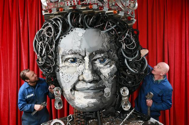 The Queen of Parts sculpture comprises over 800 car and truck parts