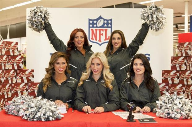 The NFL cheerleaders will visit Tesco Extra Wembley on Wednesday (30 September)