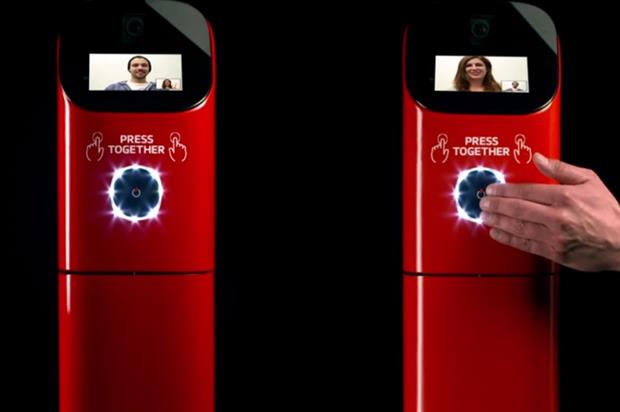 The machines featured screens for videos as well as a button which revealed the coffee dispenser