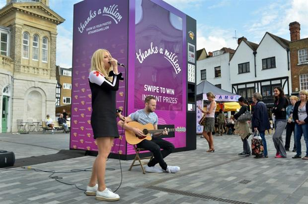 Lott performs for a suprised Nectar Card holder