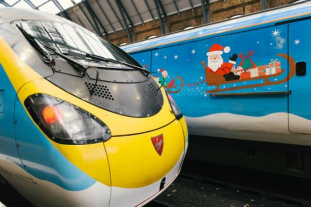Two of Virgin's trains have been transformed to showcase childrens' Christmas designs