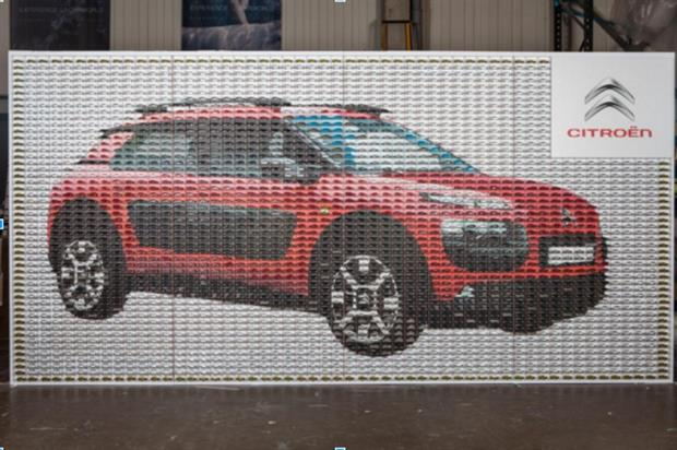The mosaic comprises almost 3,000 toy model cars