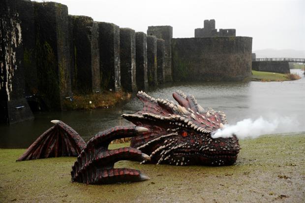 The four-metre long dragon breathes smoke