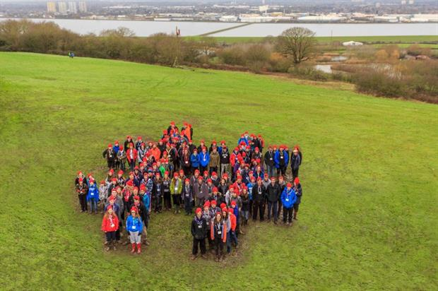 Scouts celebrated the news with a human hashtag formation