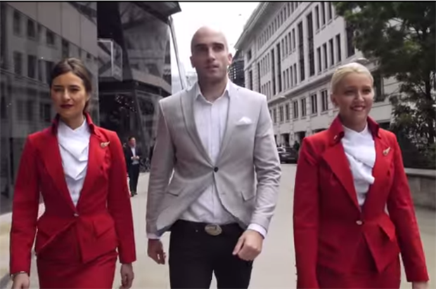 DMC was flanked by Virgin Atlantic cabin crew