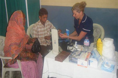 Tracey Clay treating a patient at a clinic