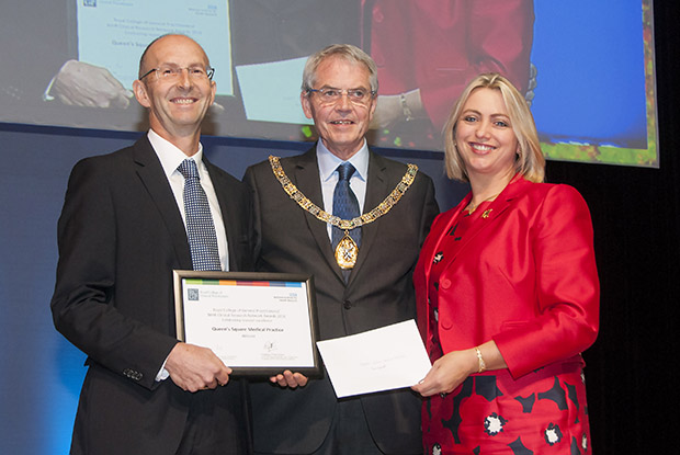 Dr Simon Wetherell from Queen's Square Medical Practice receives the award from RCGP president Dr Terry Kemple and RCGP chair elect Dr Helen Stokes-Lampard