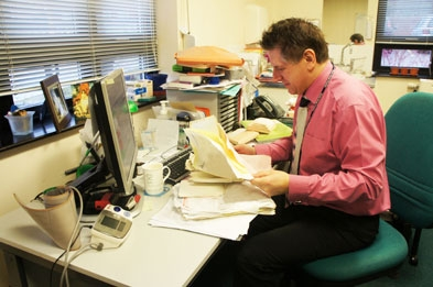 Dr David Wilson (picture before the switch): 'Receptionists absolutely love it as they no longer get covered in dust.'