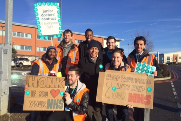 BMA deputy chairman Dr Kailash Chand (centre) with junior doctors on strike in Manchester