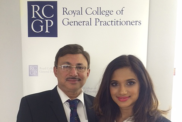 Dr Thomas Abraham with his daughter - and fellow GP - Dr Rowena Abraham
