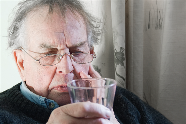 Asking a patient to hold a glass of water is useful test for tremor (Photo: iStock)
