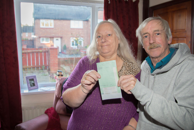Patients Margaret and John Boulton with their boiler prescription: 'This has really changed our lives.'