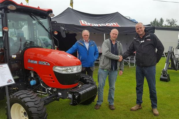 L-R Robin and Chris Moir of Agri-Services with Branson Tractors UK sales manager Stuart Winwood. Image: Supplied