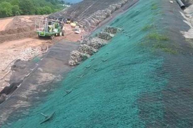 Contractors have laid Enkamat mat and Proganics substrate onto roadside slopes pre-seeding. Image: Costain