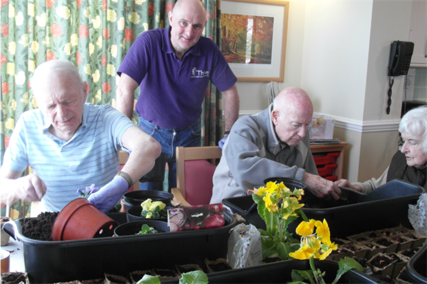 Daron Gardner with care home residents Leslie and Dennis. Image: Thrive