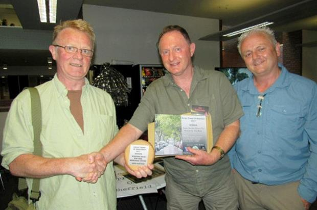 Robin Ridley (left) receives an award from Professor Ian Rotherham, at the event organised by Rob McBride (right) - Image: The Tree Hunter