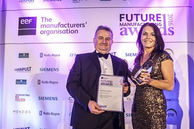 HydroGarden commercial sales manager Stephen Fry collects the award - image: EEF