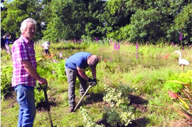 Volunteer gardeners Paul Davey, left, and Michael Moore at the Norfolk Hospice garden. Image: Supplied