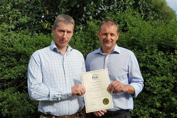 Peter Watson (left)  receives his certificate from the PCA's Steve Hodgson