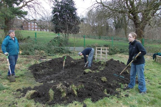 Volunteers dig out an area for a bog garden at Buile Hill Park. Image: Supplied