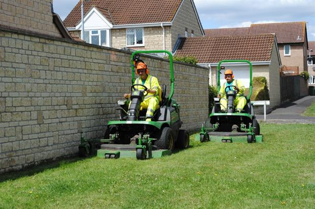 The Landscape Group operatives use the new mowers. Image: Supplied