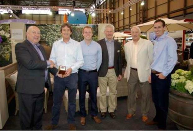 Paul Bevington (left) presents Bramblecrest with Solex best stand award