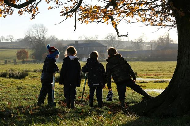 Children help to plant trees at Brown's birthplace Kirkharle Hall. Image: Capability Brown Festival