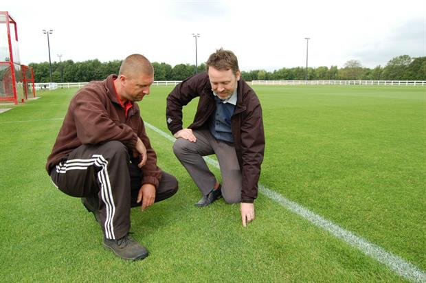 Head groundsman Neil Rogers, left, with Rigby Taylor's technical representative Jamie Applegarth. Image: Supplied