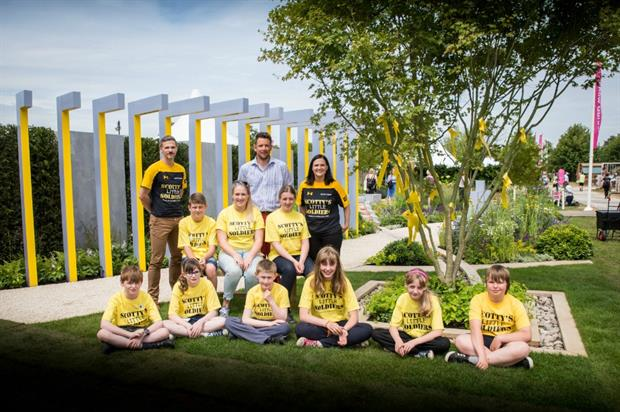 L-R CEO Stuart Robinson, designer Graeme Thirde, founder Nikki Scotty with children supported by the charity. Image: Supplied
