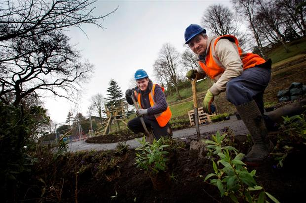 Andrew Embleton & Matt Ayley of Brambledown Landscape Services plant flowers at Wharton Park. Image: Supplied