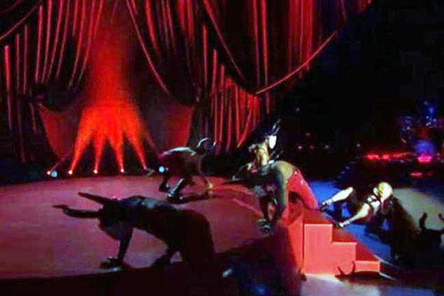 Madonna in mid-song tumble at Brit Awards thanks to stubborn Armani cape
