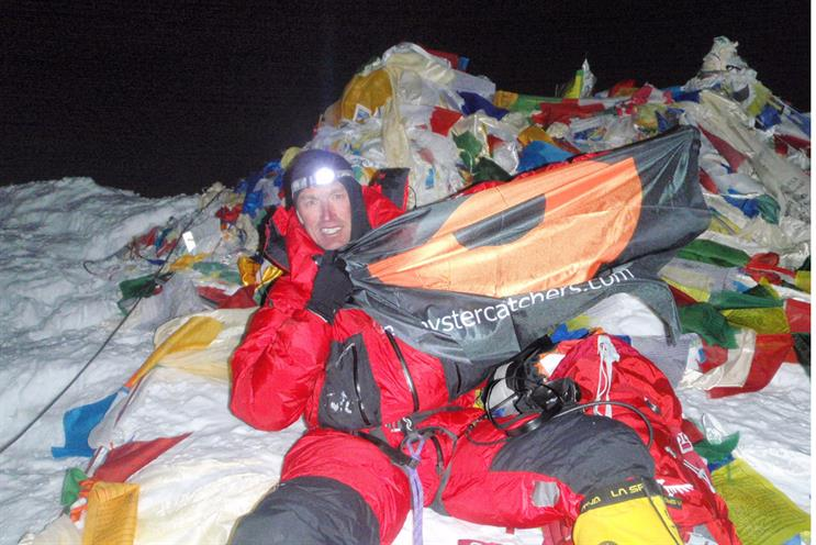 Kenton Cool: unveils the Oystercatchers flag on the summit of Everest
