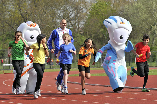 McDonald's: happy meal drive features 2012 mascosts Wenlock and Mandeville