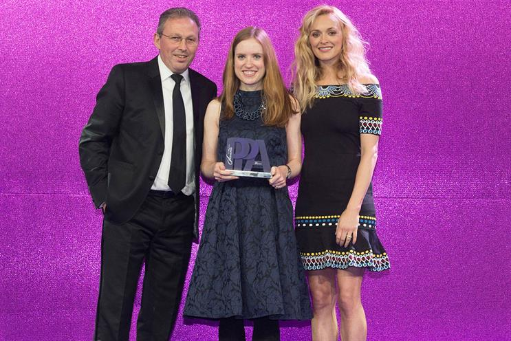 Kate Magee (center) won Business Writer of the Year