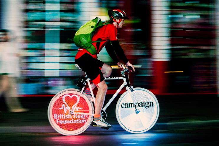 Bespoke ad: the Campaign logo is projected Bespoke ad: the Campaign logo is projected during the charity night ride  the charity night ride
