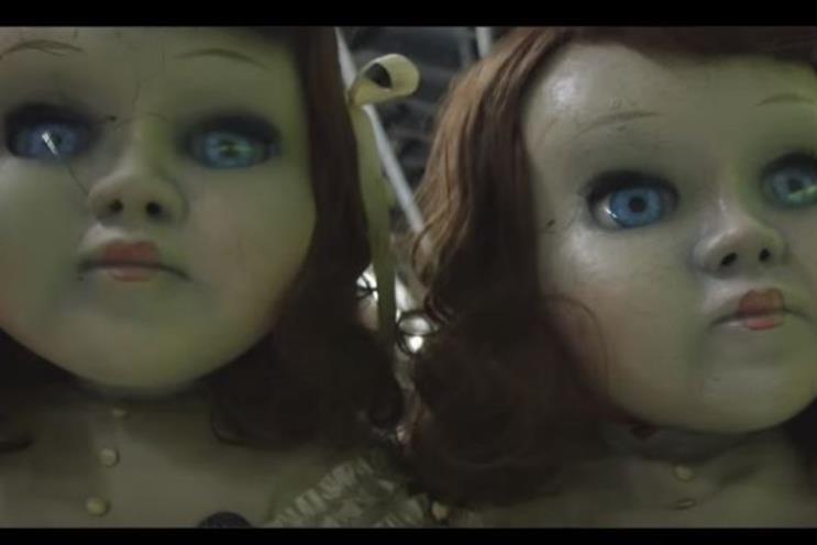 Spooky-eyed lifesize dolls stalk London underground in Derren Brown stun