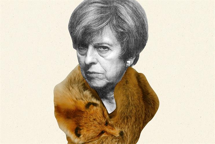 i newspaper depicted Theresa May with a fox fur stole