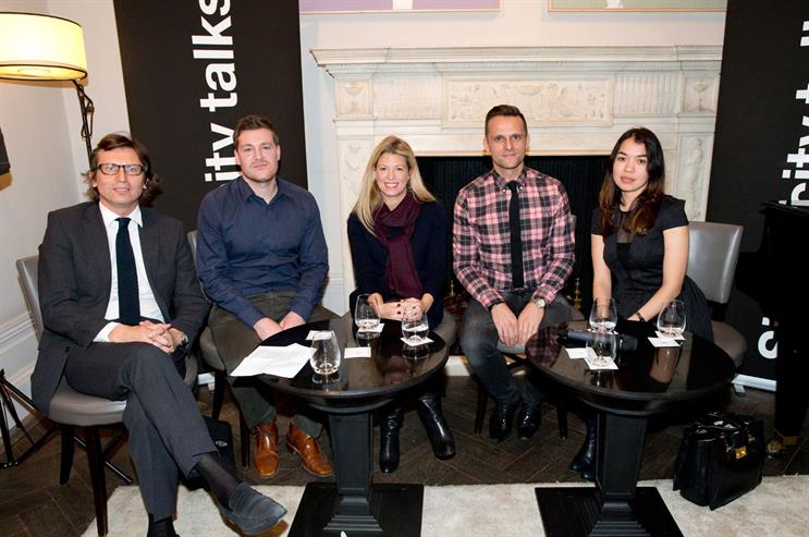 The panel of luxury brand experts at the event moderated by Siegel+Gale President Philip Davies (far left)